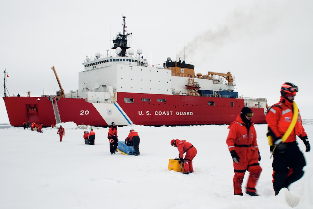 Scientists and Coasties begin another ice deployment.