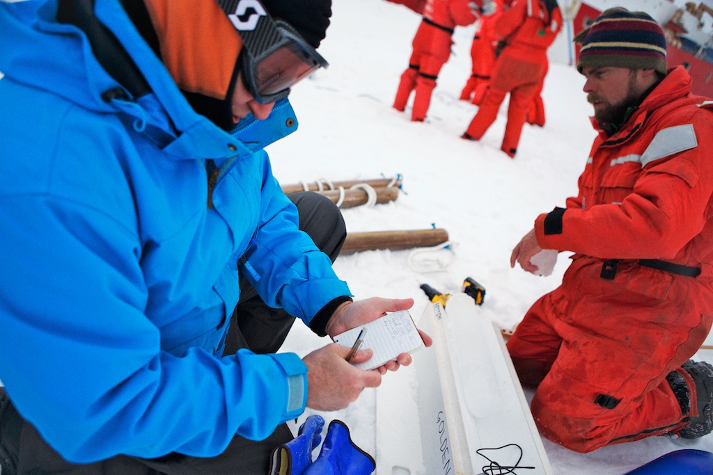 Ken Golden and Chris Polashenski measure the ice core temperature.