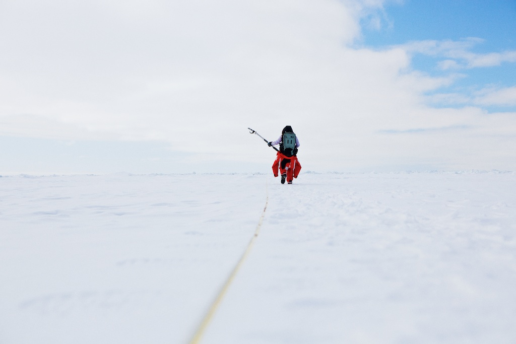 Caroline Stwertka uses a spectroradiometer to measure the ice albedo.