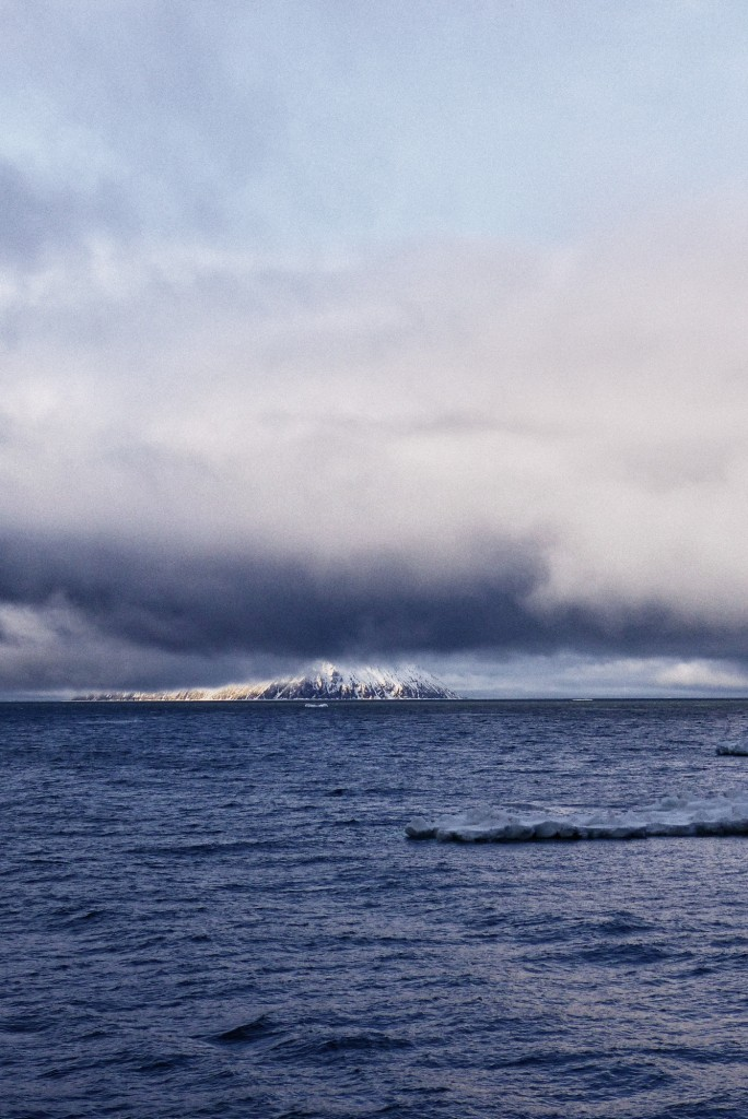 Fog lifts over Little Diomede Island