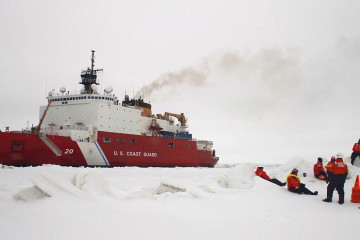 After breaking free from its anchor on the ice, Healy realigns to allow the crew to board. The crew waits behind an ice ridge.