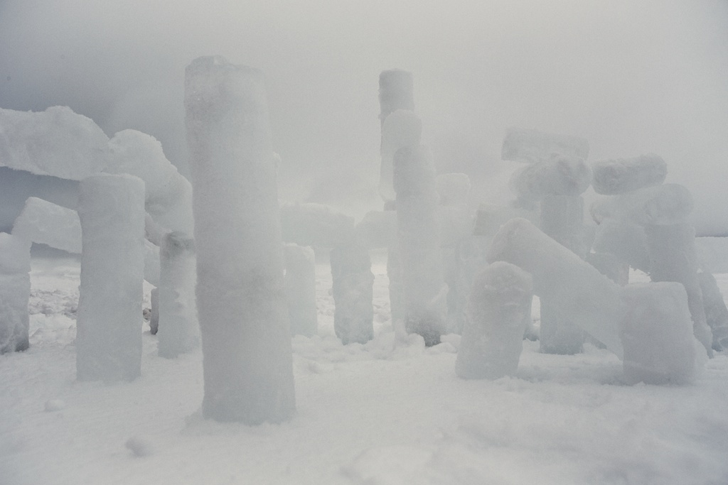 "Ice Henge ""towering"" above the matted snow."